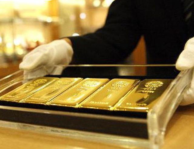 Giá vàng tăng vọt lên đỉnh 3 tuần, ồ ạt mua vào - Ảnh 2.