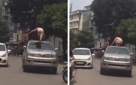 Người phụ nữ đùng đùng trèo lên nóc xe ô tô nhảy nhót, múa may nhưng hành động của tài xế lại gây tranh cãi dữ dội